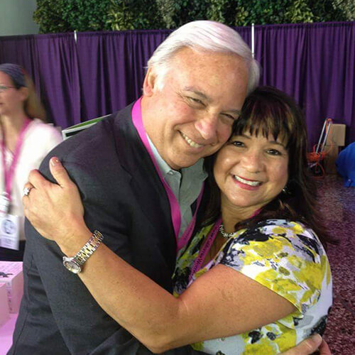 "Rose Tafoya Huging Jack L. Canfield author of the book ""Chicken Soup for the soul"""